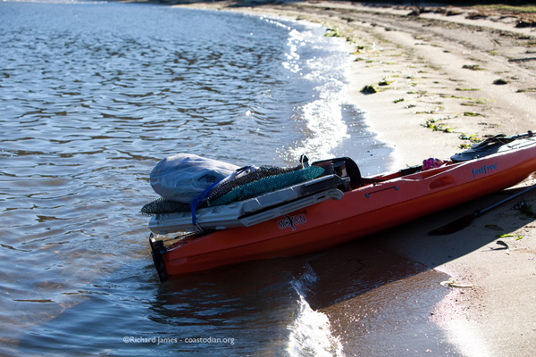 Kayak loaded with plastic
