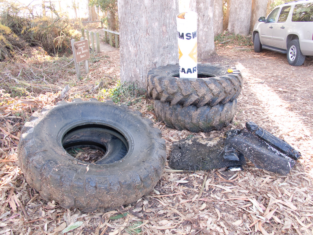Four tires, a buoy and two oyster grow-out bags.