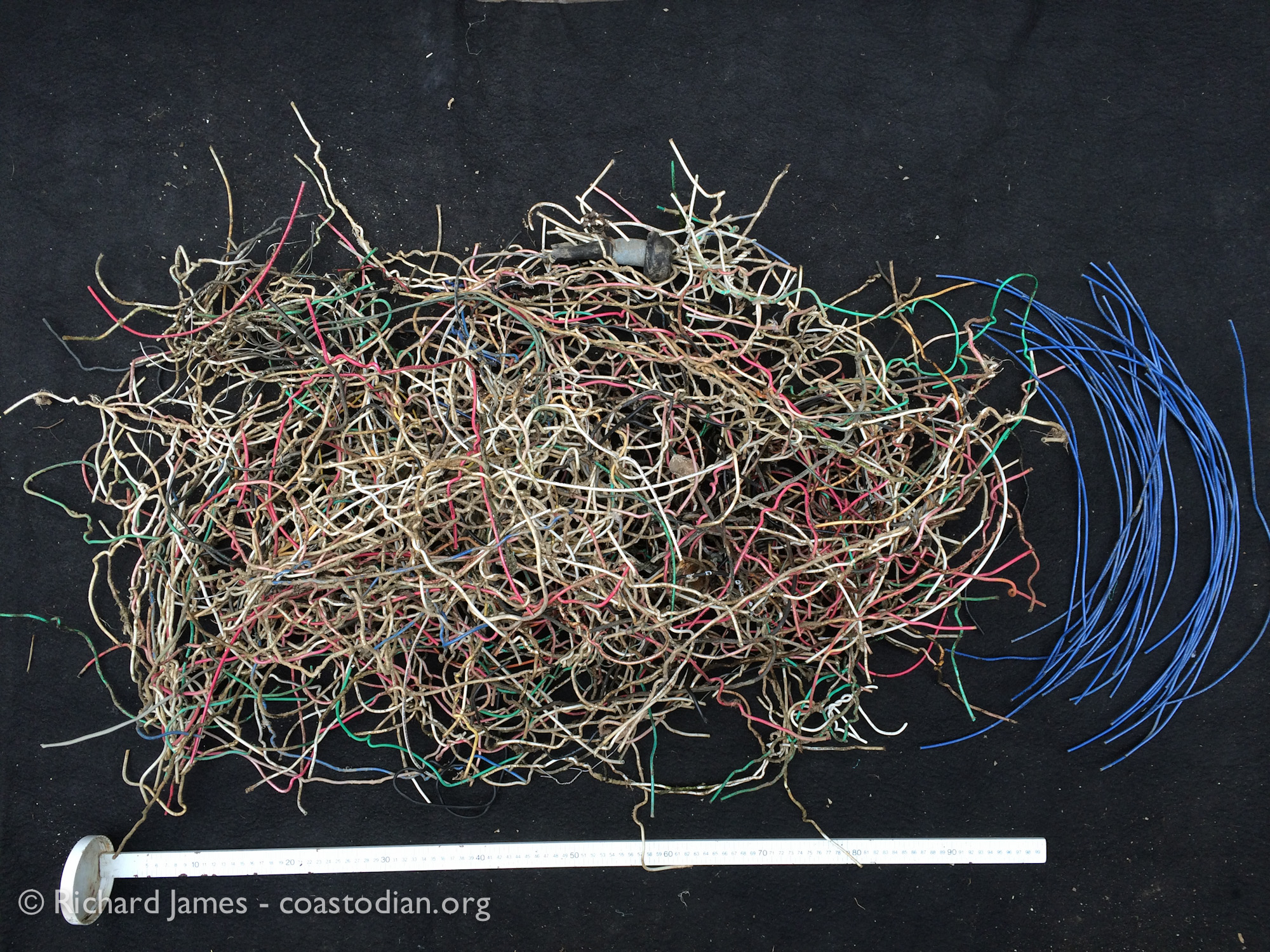 Small fraction of the plastic coated copper wire (en español: cables) collected from leases of TBOC