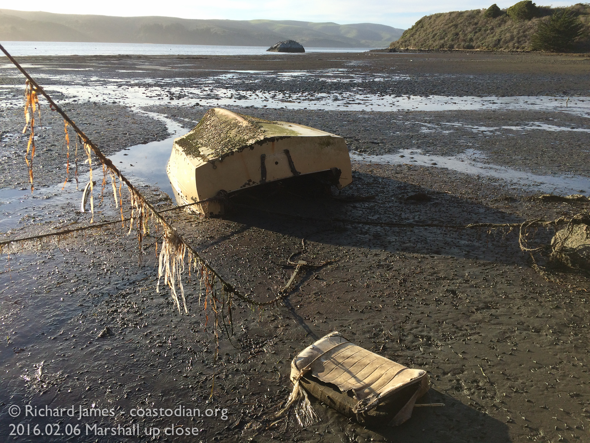 Capsized boat, seat cushion making an escape. ©Richard James - coastodian.org