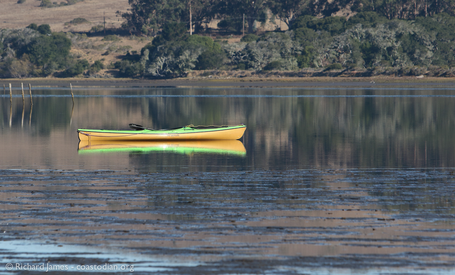 "Salvage kayak ""Deep Respect"" drifts on a flood tide in southern Tomales Bay"